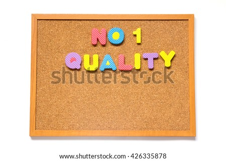 Corkboard with wording no.1 quality placed on white background - stock photo