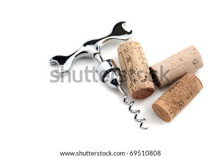 Corks and corkscrew over white - stock photo