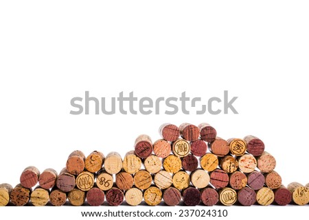 Corks stacked at random heights against white background. - stock photo