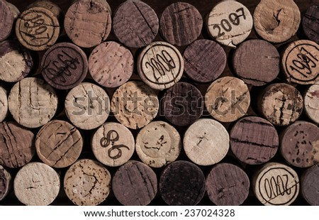 Corks stacked on their side with ends facing outward and desaturated.