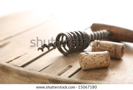 Corkscrew and two corks - stock photo