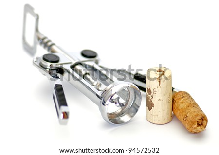 Corkscrew and Two Wine Corks isolated on white background - stock photo