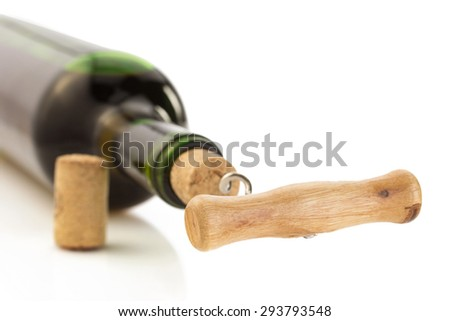 corkscrew and wine bottle isolated on white background - stock photo