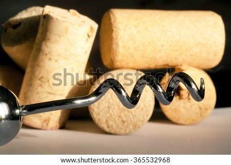 Corkscrew and wine cork on background. Set of wine gourmet. - stock photo