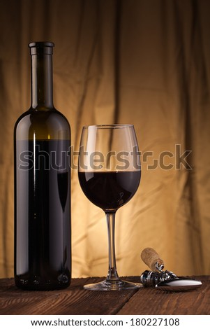 corkscrew glass  and wine bottle