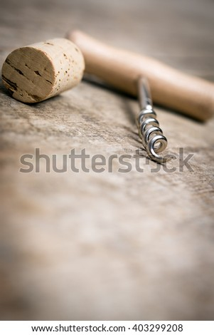 corkscrew on a wooden background, lot of copyspace