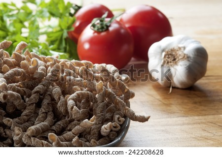 corkscrew shaped raw pasta called busiate with whole wheat flour  of buckwheat typical of Sicily - stock photo