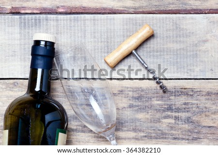 Corkscrew wine bottle and glass on the wooden table.toned  - stock photo
