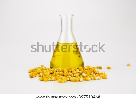 Corn and oil isolated on white - stock photo