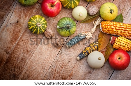 Corn, apple and pumpkin - gourd family - stock photo