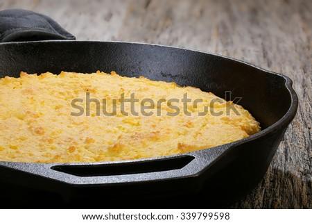 Corn bread baked in flat iron skillet - stock photo