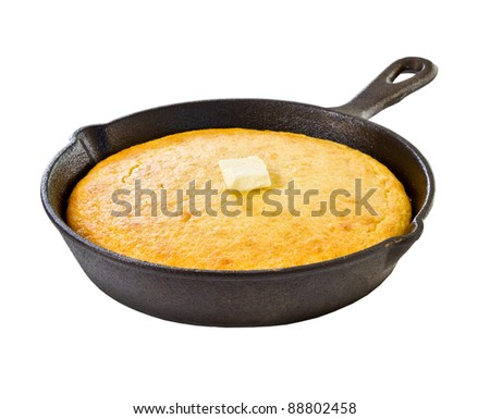 Corn bread in iron skillet isolated on white