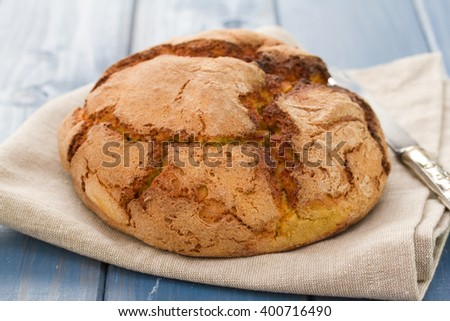 corn bread on napkin with knife
