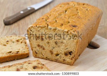 corn bread with dried paprika on a wooden board horizontal