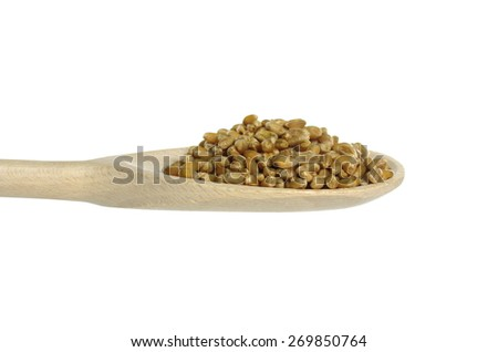 corn cereal on wooden spoon on white background - stock photo