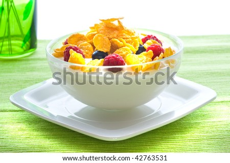 Corn flakes and fresh berries - stock photo