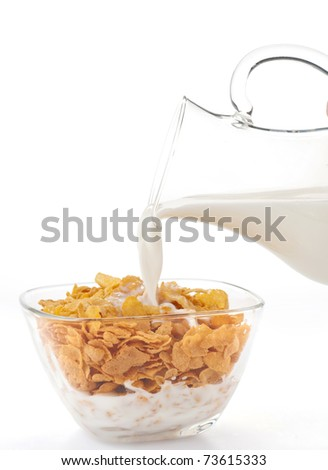 Corn flakes and milk - stock photo