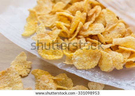Corn-flakes overflow from plastic bag