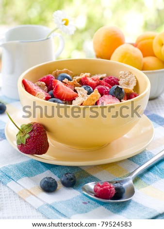 Corn flakes with fresh berries. Selective focus