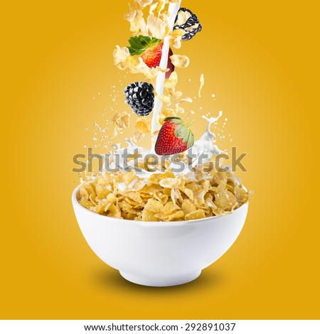 Corn Flakes With Strawberry and Blackberry Falling into A Bowl of Milk Splash