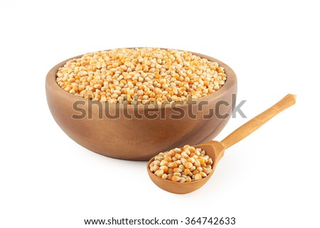 corn grain in wooden kitchen utensils