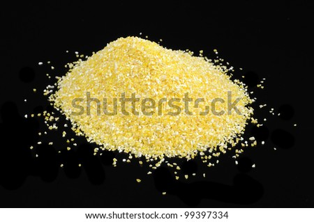 Corn Grits on Black Background - stock photo