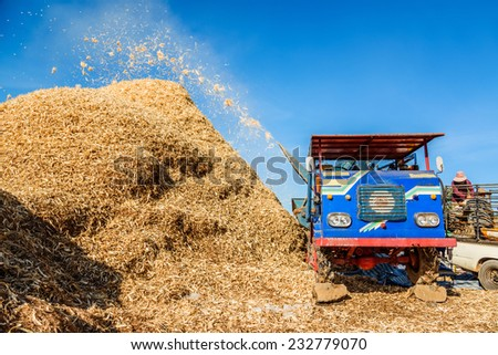 Corn harvesting by combine harvester in Mae Chaem, Chiang Mai, Thailand.  - stock photo