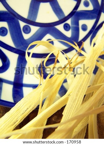 corn husks with blue and white plate - stock photo