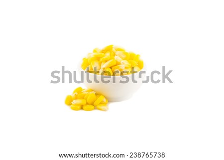corn kernels isolated over white background - stock photo