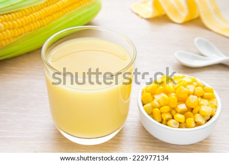 Corn milk in glass, kernel corn in bowl and fresh corn   - stock photo
