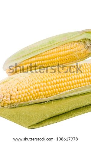 Corn on a white background and green texture - stock photo