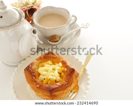 corn pastry and milk tea on white background for gourmet breakfast image - stock photo