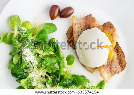 corn salad /sprinkled with olive oil, lemon juice, and parmesan/,  and fried toast with pork slices and poached egg