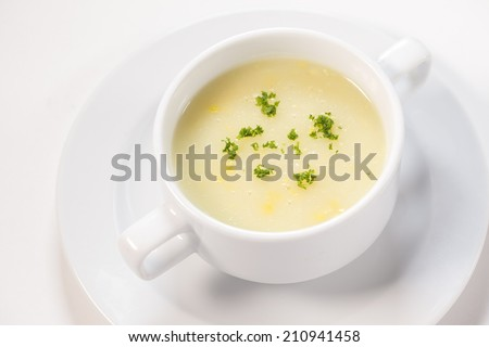 Corn Soup on white background - stock photo