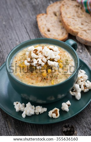 corn soup with popcorn, vertical, top view