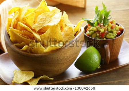 corn tortilla chips in a wooden bowl - stock photo