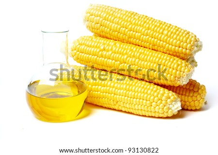 Corn with oil isolated on white - stock photo