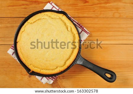 Cornbread in a cast iron skillet photographed from above - stock photo