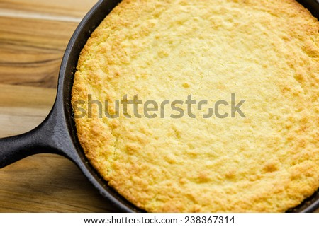 Cornbread made in a cast iron skillet.  - stock photo