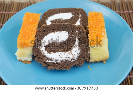Cornbread sliced with egg custard and chocolate on plate.  - stock photo