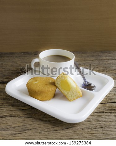 cornbread with coffee on old wood. - stock photo