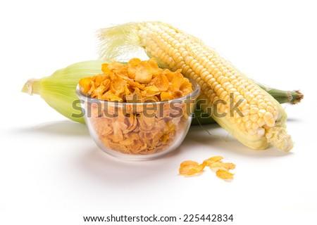 Corncob and cornflakes isolated on white background - stock photo