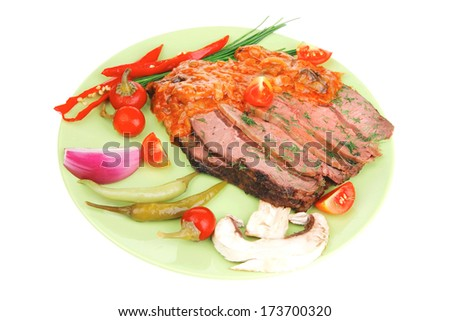 corned beef on plate with vegetables isolated over white