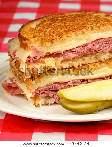 Corned Beef Reuben Sandwich - Fresh corned beef on grilled Rye with melted Swiss and sauerkraut. - stock photo