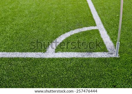 Corner boundary markings of grass soccer field - stock photo