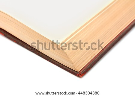 Corner detail of a blank page in a shabby, bound hardback book on a white background - stock photo
