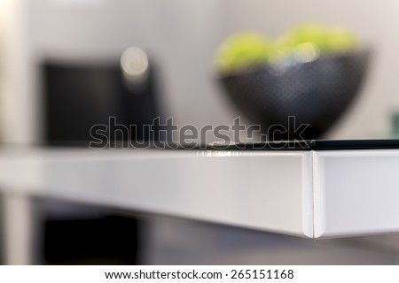 Corner detail of modern black and white table - stock photo