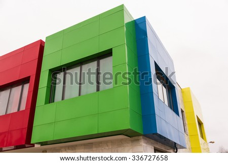 Corner detail of modern building with a facade of colors - stock photo