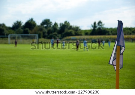 Corner flag in a soccer field - stock photo