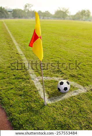 Corner flag with ball on a soccer field - stock photo